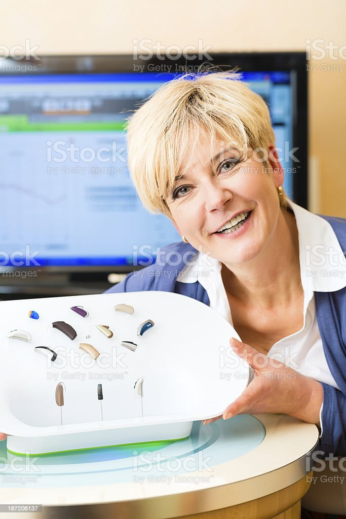 Deaf woman with hearing aids stock photo