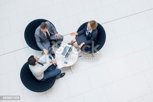 Three business people sealing a business deal.