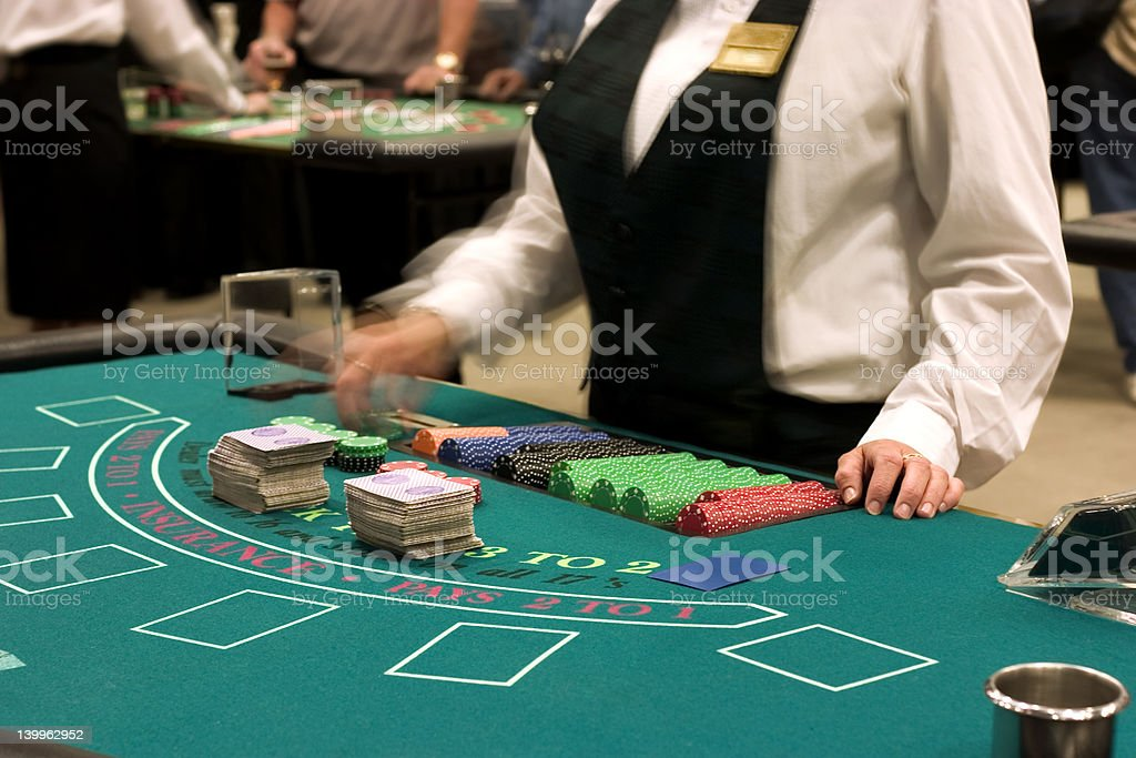 dealer at blackjack table royalty-free stock photo