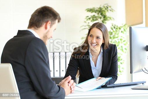 istock Dealer attending to a customer 638126330