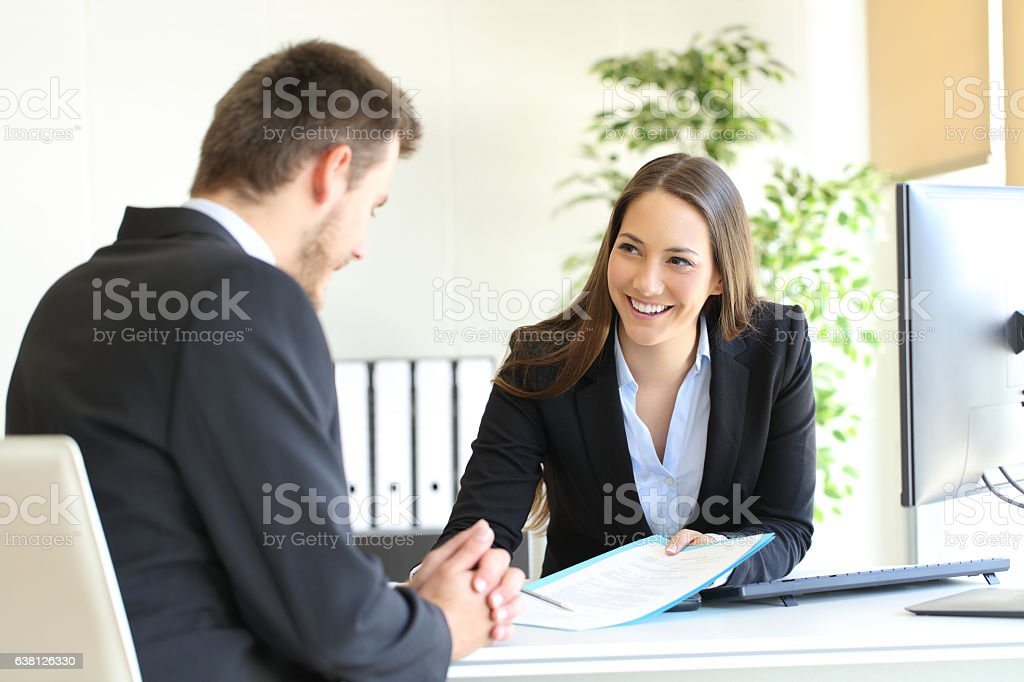 Dealer attending to a customer stock photo