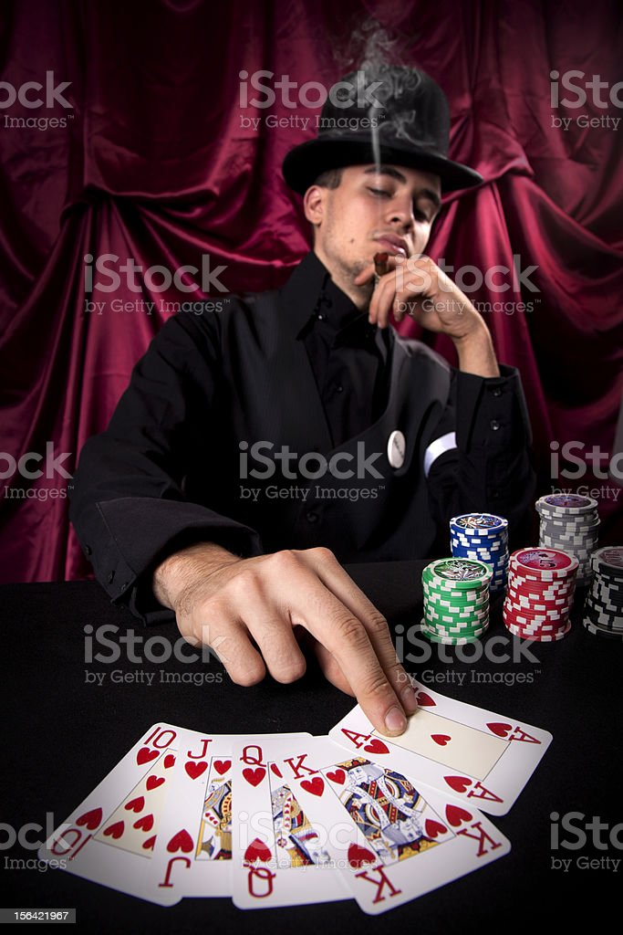 Dealer draw last card for royal flash royalty-free stock photo