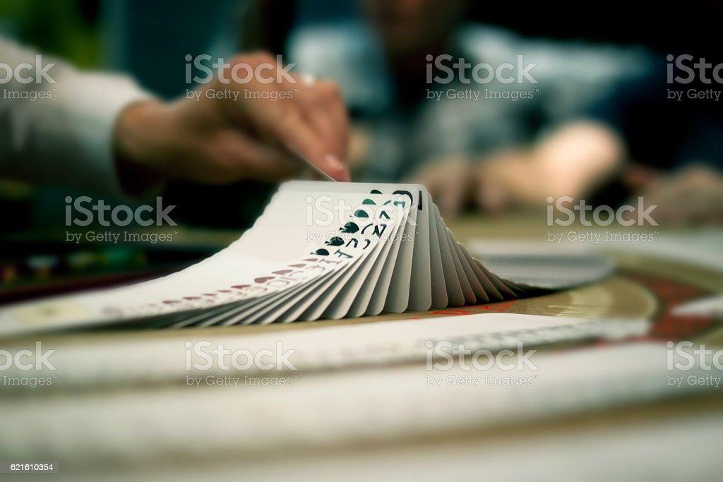 Dealer flipping cards stock photo