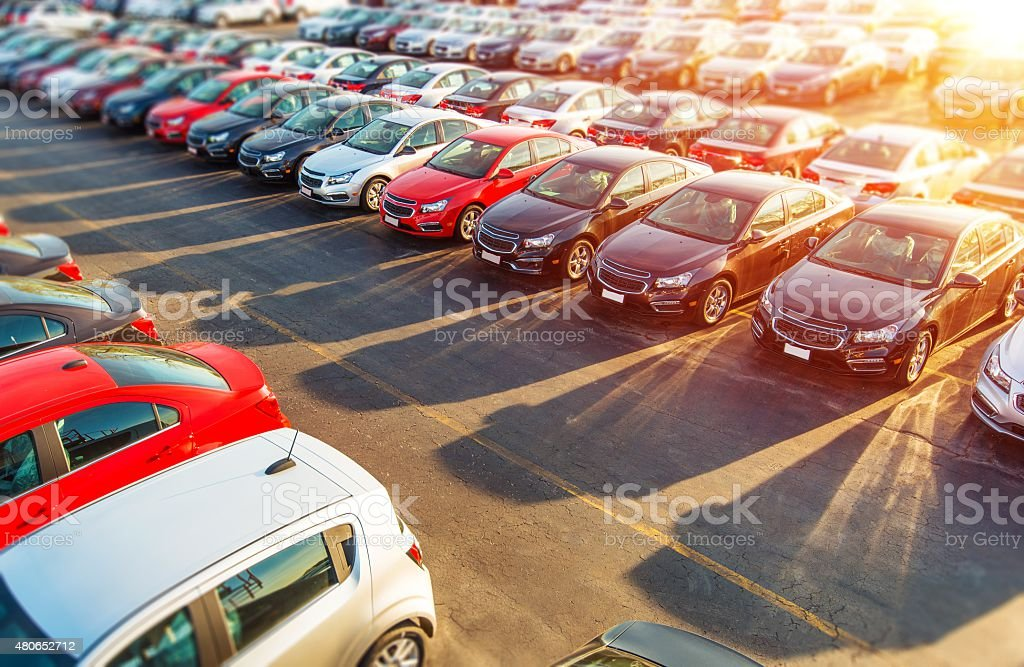 Dealer New Cars Stock Dealer New Cars Stock. Colorful Brand New Compact Vehicles For Sale Awaiting on the Dealer Parking Lot. Car Market Business Concept. 2015 Stock Photo