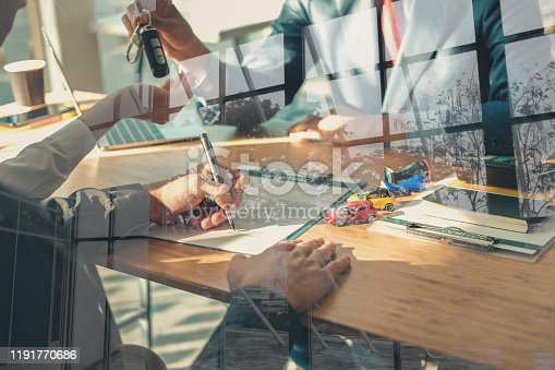 936987338 istock photo dealer salesman giving car key to owner. client signing insurance document or rental car lease form 1191770686