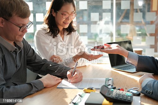 936987338 istock photo dealer salesman giving car to owner. client signing insurance document or rental car lease form 1193614106