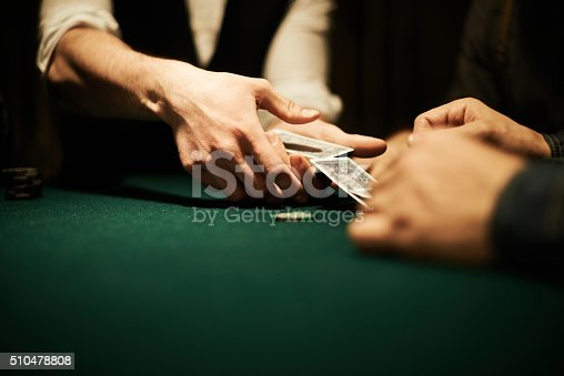 Male hands dealing cards