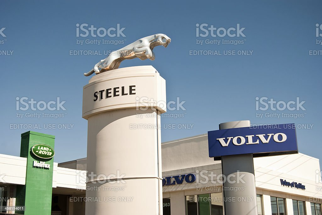 Dealership Sign Against Clear Sky stock photo