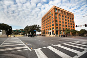 Dallas: The Texas School Book Depository, now known as the Dallas County Administration Building, is a seven-floor building facing Dealey Plaza in Dallas, Texas, United States. The building is most notable as the vantage point of the assassination of John F. Kennedy on November 22, 1963. An employee, Lee Harvey Oswald, shot and killed Kennedy from a sixth floor window on the building's southeastern corner. The structure is a Recorded Texas Historic Landmark.