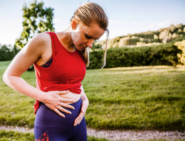 Dealing With Stomach Pain stock photo