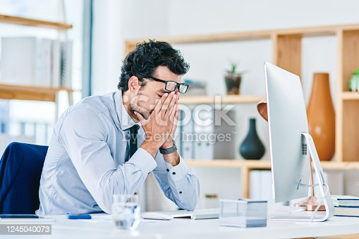 913327640 istock photo Dealing with the burden of stress at work 1245040073