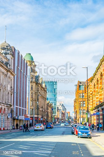Manchester, UK, April 11, 2017: View of the classical brick houses on Deansgate street in Manchester, England