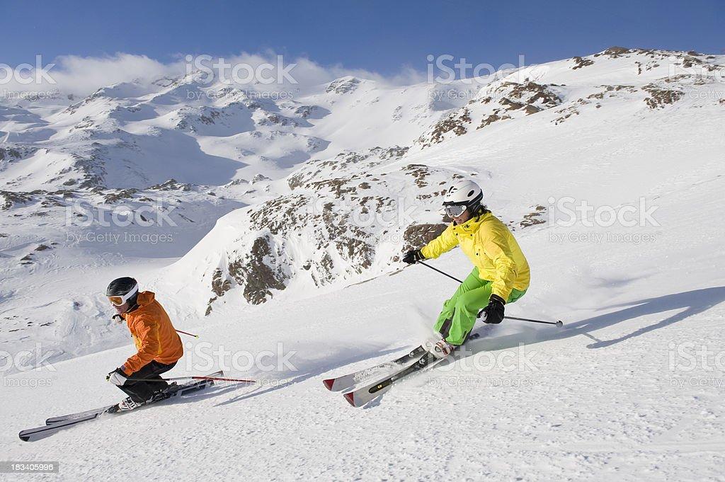 dear couple enjoy skiing with helmet stock photo