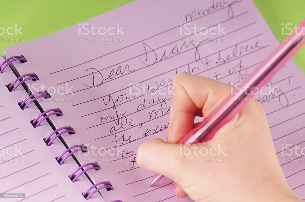 Dear Diary Letter Written With Pen Against Purple Paper stock photo