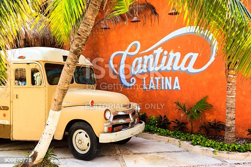 COSTA MAYA - MEXICO JAN 30 2016: Retro settings with an old bus at  Costa Maya cruise ship terminal & resorts. This place for all - young and old - since many attractions awaiting.