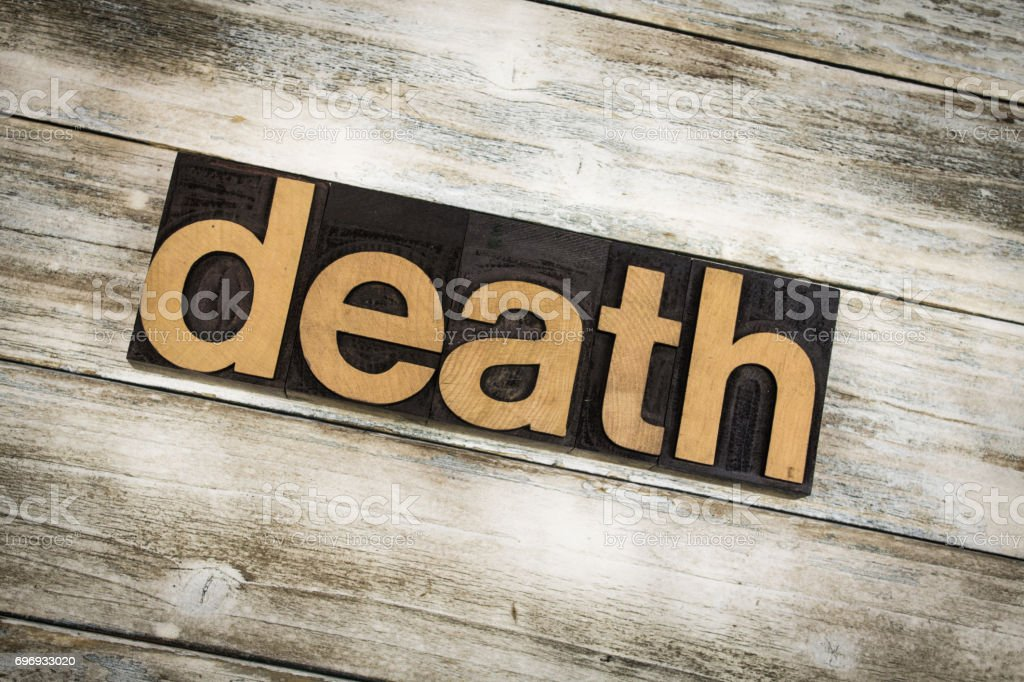 Death Letterpress Word on Wooden Background stock photo