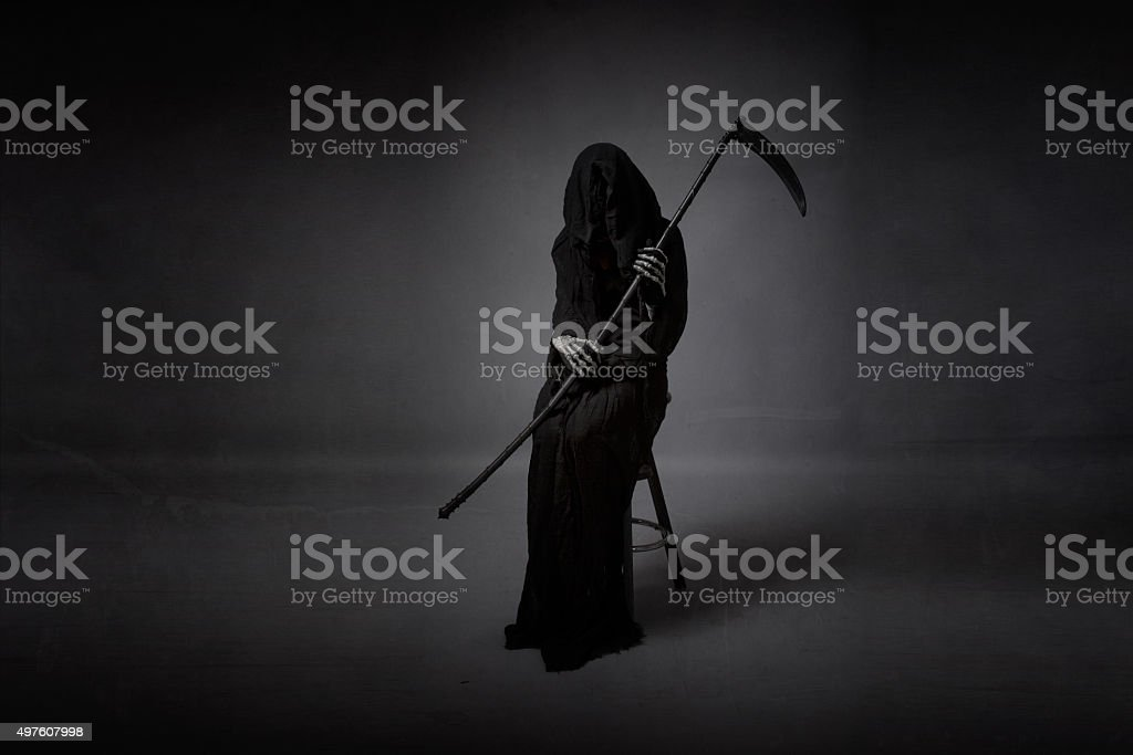 death sitting with arms on hand stock photo