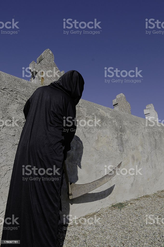 Death stalking the Graveyard stock photo