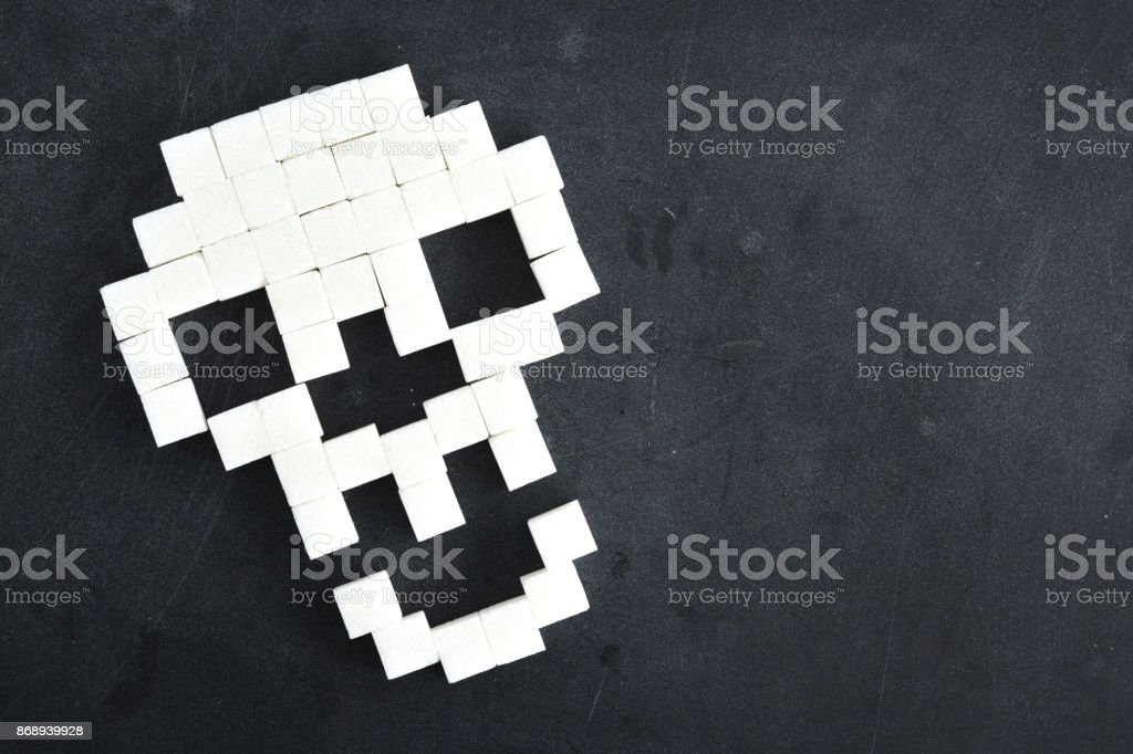 Death Symbol With Skull Shape From Sugar Cubes On Dark Background