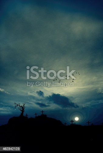 composition image of Spooky Halloween graveyard with dark clouds