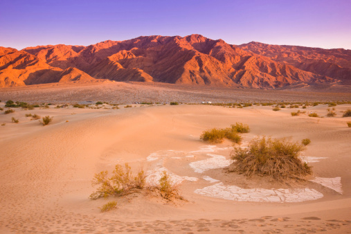 Colorful sunset over Mesquite dunes of Death Valley California