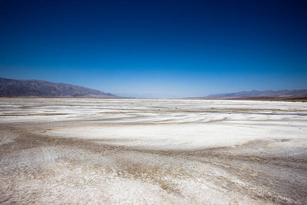 Death Valley California USA Death Valley Desert to the Horizon. Shot at 282 feet (86 m) below sea level, California, USA. lake bed stock pictures, royalty-free photos & images