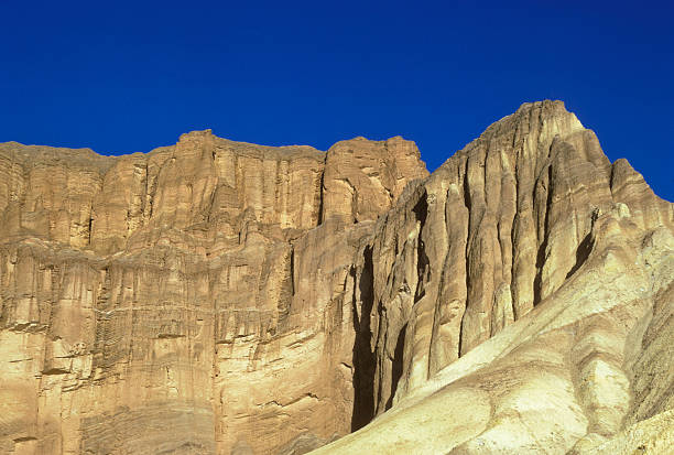 Death Valley cliff face Looking up at cliffs in Death Valley, California. hearkencreative stock pictures, royalty-free photos & images