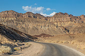 A road in Death Valley, leading towards rugged mountains