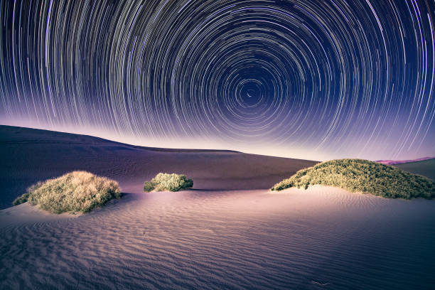 Death Valley National Park with light painting and star trails stock photo