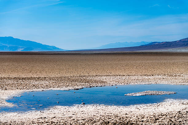 Death Valley Death Valley is a desert valley located in Eastern California. It is the lowest, driest, and hottest area in North America. lake bed stock pictures, royalty-free photos & images