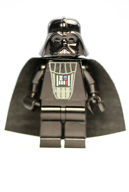 Deathly Grin Vancouver, Canada - December 9, 2012: A Lego Darth Vader from the Star Wars film franchise, posed against a white background. deathly stock pictures, royalty-free photos & images