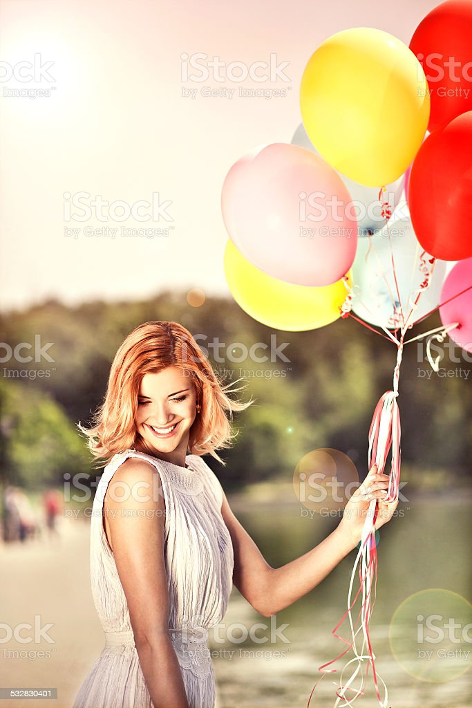Deautiful girl with ballons stock photo