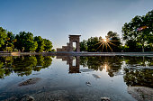 Sunset in Debod Temple with reflections on the lake surrounding it