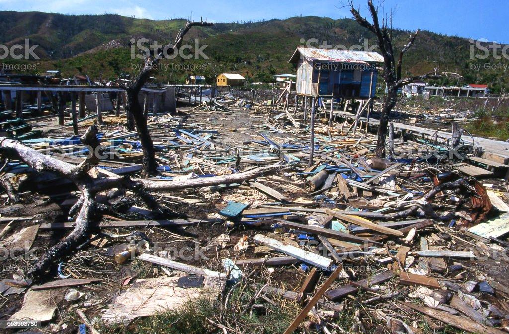 Debris remaining in pond and destruction from 1998 Hurricane Mitch in Savanna Bight village Guanaja Bay Islands Honduras stock photo