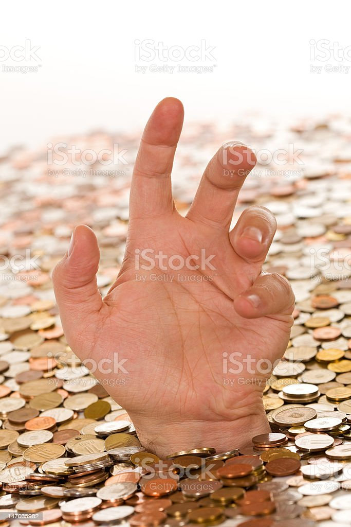 Debt and bad finances concept - drowning in money royalty-free stock photo