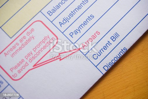 utility bill with arrears and warning