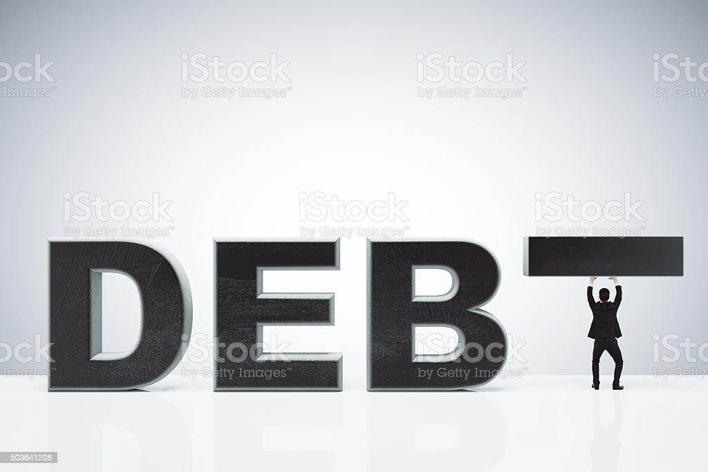 Долгового Бремени Задолженности Концепция В Word И Бизнесмен Держа Inste —  стоковые фотографии и другие картинки Банкротство - iStock