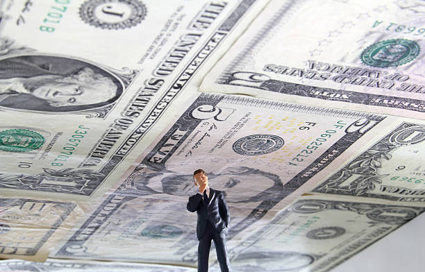 Debt Ceiling Political figure standing under a ceiling made of US money. debt ceiling stock pictures, royalty-free photos & images