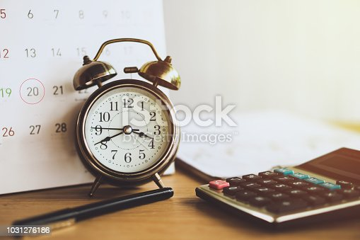 istock debt collection and tax season concept with due date on calendar with alarm clock on desk 1031276186