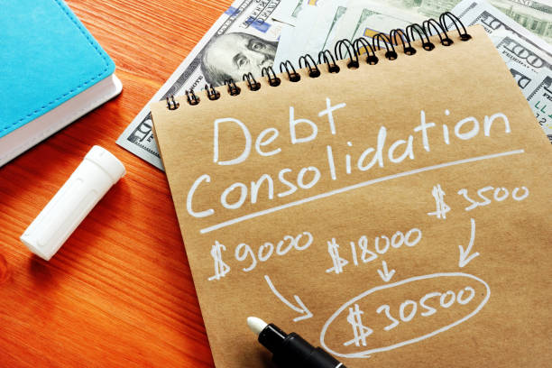 Debt consolidation title with written calculations. stock photo