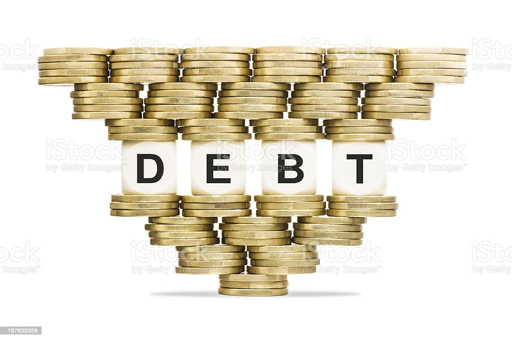 Debt Management Word on Unstable Stack of Gold Coins stock photo