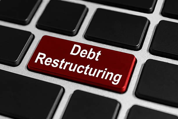 debt restructuring button on keyboard stock photo