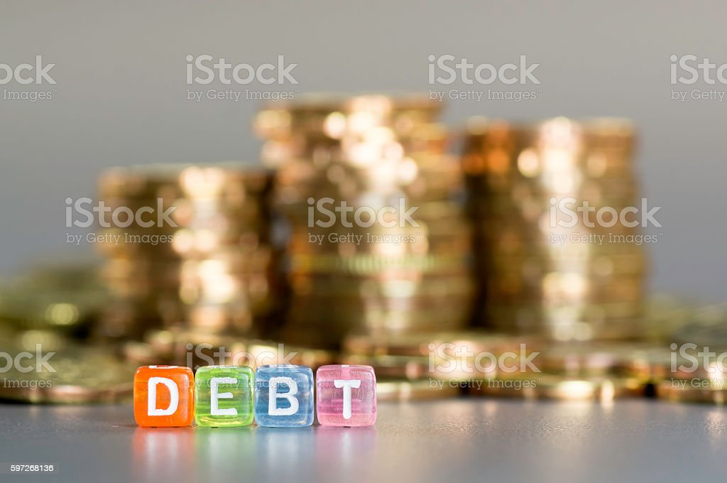 Debt text and gold coin royalty-free stock photo