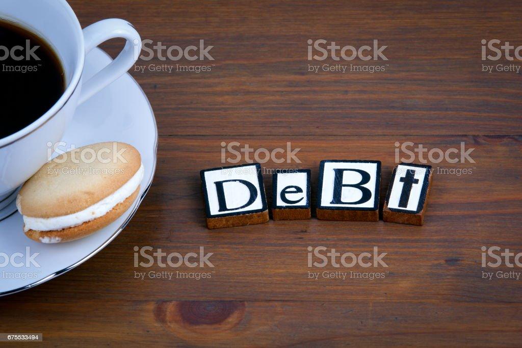 Texte de dette sur un fond en bois photo libre de droits