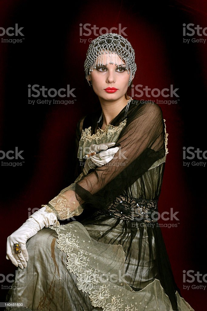 Decadance with a red fan royalty-free stock photo
