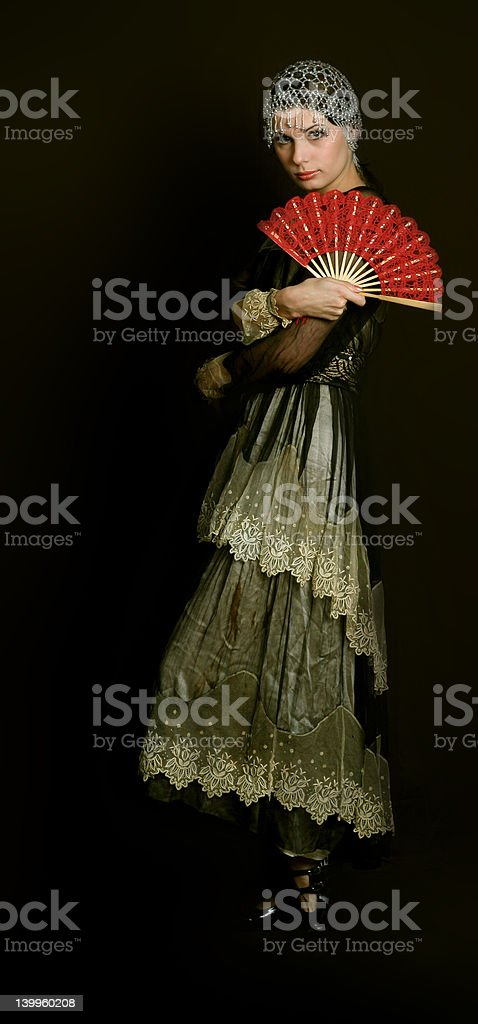 Decadanse with a red fan royalty-free stock photo