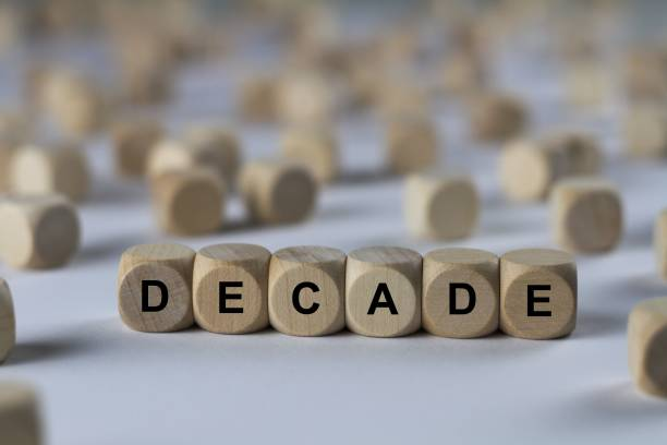 decade - cube with letters, sign with wooden cubes - decagon stock pictures, royalty-free photos & images
