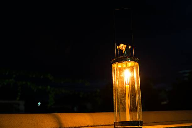 decagon glass lamp, candle light in the darkness. - decagon stock pictures, royalty-free photos & images