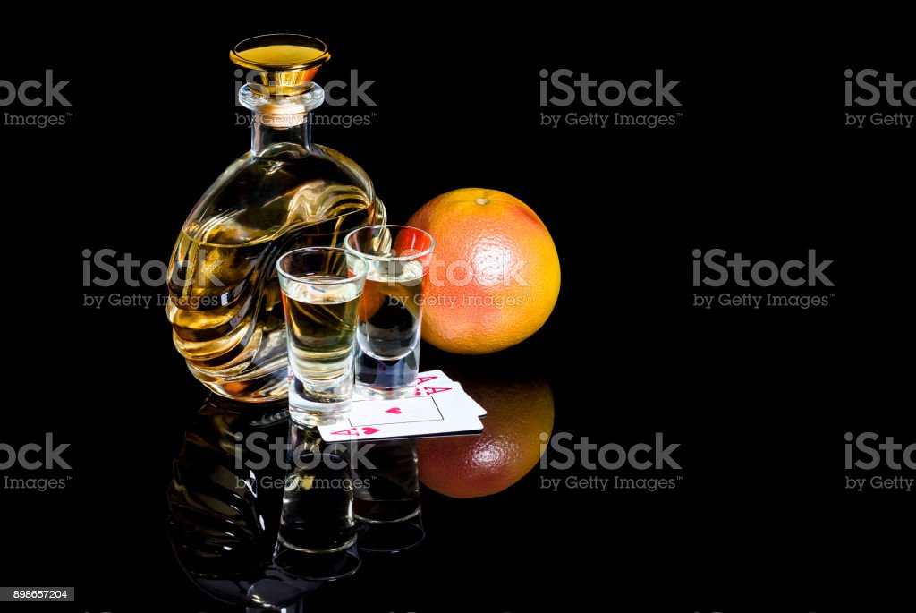 Decanter and Shot glasses of tequila with cards and Grapefruit stock photo