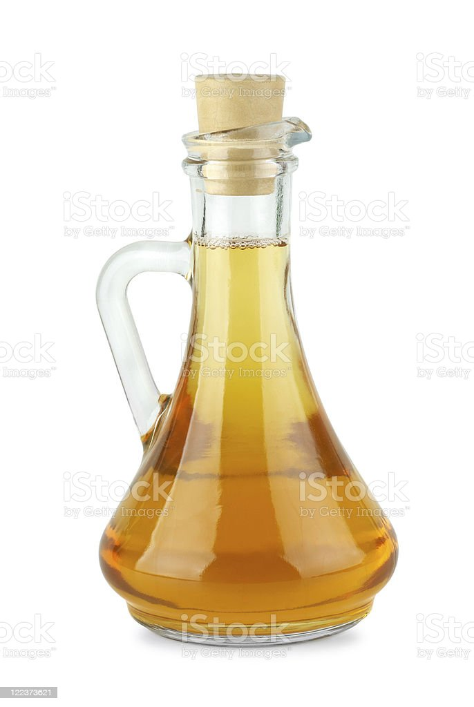Decanter with apple vinegar royalty-free stock photo